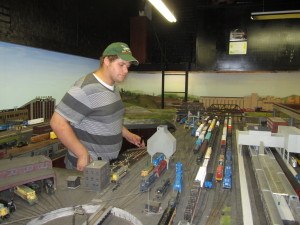 Brandon Townley, newest member of Marion Model Railroad Club; running some Conrail power