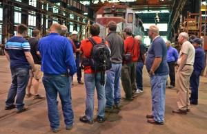 The American Steam Railroad tour group attentively listening to stories of how the W&LE does business (B McG Jr.)